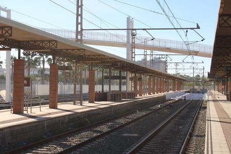 View of a train station and railway tracks in the city