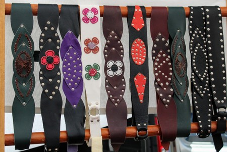 Leather belts for women with floral and leaf motifs in different shades 写真素材 - 123663370