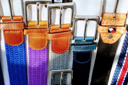 Fabric belts in bright colors with leather finish and steel buckles 写真素材 - 123663373