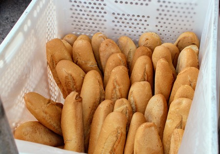 Plastic box full of freshly baked bread and ready to sell 写真素材
