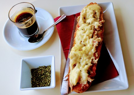 Delicious breakfast with coffee toast of tuna , cheese and oregano