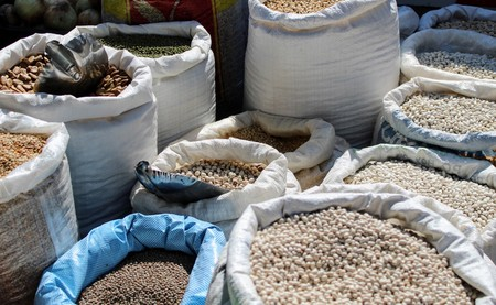 Larges sacks of raffia filled with different legumes of mediterranean origin