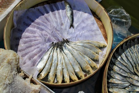 Dry anchovies arranged in a circle in special wooden pots 写真素材 - 123663513