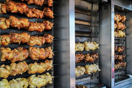 Juicy chickens roasted on the spit with a nice golden color 写真素材 - 123663514