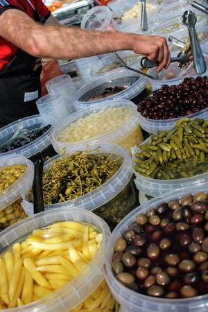 Buckets full of green and black olives , pickles and baby corn all pickled to mediterranean style 写真素材 - 123663522
