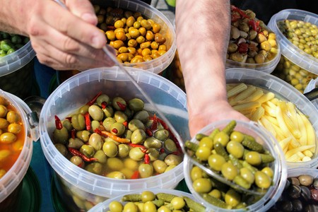 Buckets full of green and black olives , pickles and baby corn all pickled to mediterranean style 写真素材 - 123663524