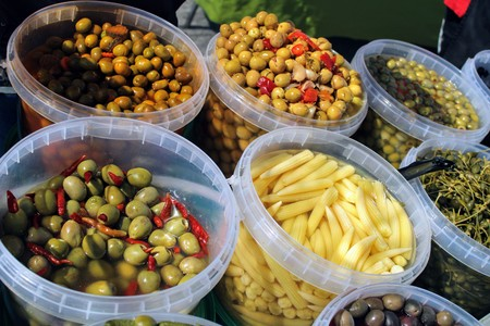 Buckets full of green and black olives , pickles and baby corn all pickled to mediterranean style 写真素材 - 123663871