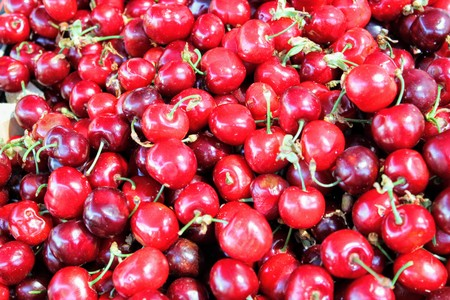 Market stall with rich and fresh red cherries
