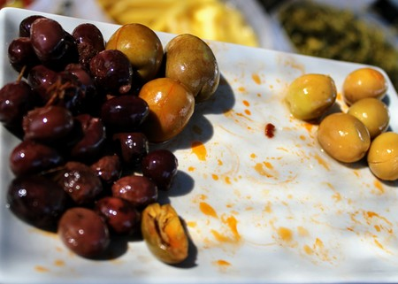 Tasty and small black olives split in the mediterranean style 写真素材 - 123663893