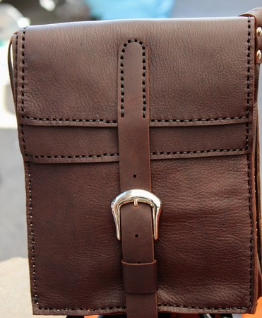 Hand stitched brown leather bag with buckle closure 写真素材 - 123664000
