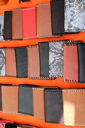 Leather wallets in different shades of brown and black , for men 写真素材 - 123664001