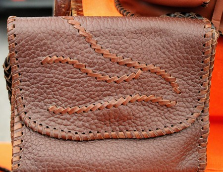 Brown leather bag with flap and wave design hand made 写真素材 - 123664005