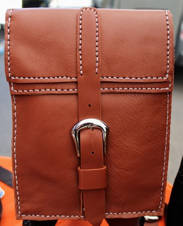Hand stitched brown leather bag with buckle closure 写真素材 - 123664009