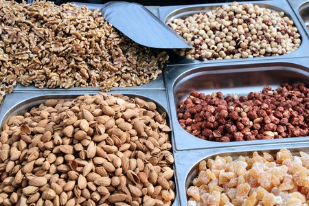 Variety of nuts in containers exposed in the market Stock Photo