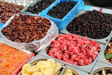 Variety of dried fruits and flowers in the market 写真素材 - 123664212