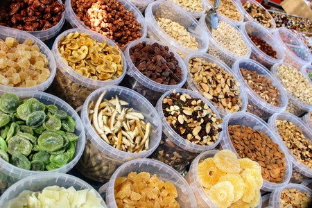 Variety of nuts in containers exposed in the market 写真素材 - 123664213