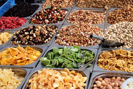 Variety of nuts in containers exposed in the market 写真素材 - 123664215