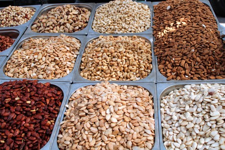 Variety of nuts in containers exposed in the market 写真素材 - 123664217