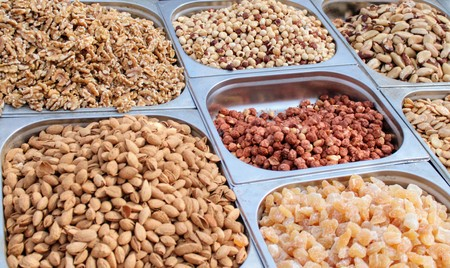 Variety of nuts in containers exposed in the market Stock Photo - 123664218