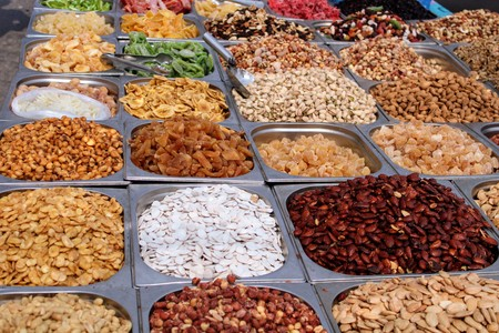 Variety of nuts in containers exposed in the market 写真素材 - 123664221