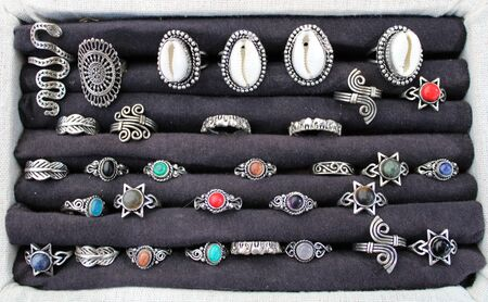 Silver rings of different models with semiprecious stone and shells