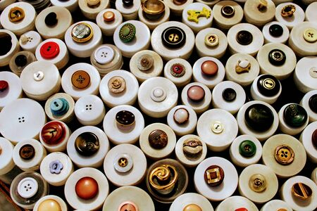 Round buttons for clothing of different sizes and models
