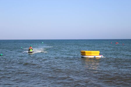 Place of leisure with hydrobicycles and water activities in the Urbanization of Roquetas de Mar of Almer�a in Spain on july 14, 2019