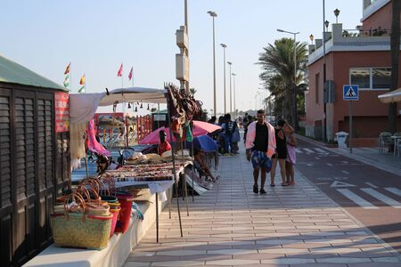 Promenade with lots of activities and leisure for tourists in the town of Roquetas de Mar of Almería in Spain on july 14, 2019 Redakční