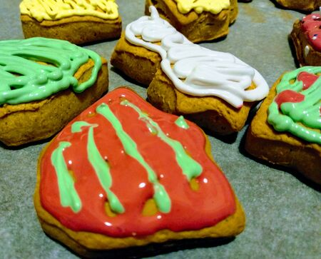 Bells , shooting star , christmas tree, made with cookie dough and colorful frosting
