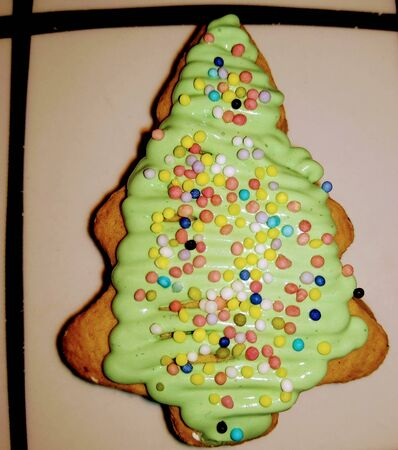 Christmas tree made with cookie dough with icing and colored shaving