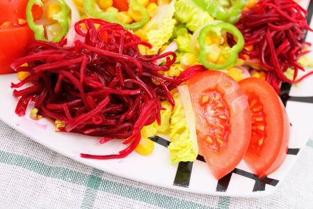 Colorful fresh vegetable salad with tomatoes , peppers , corn and lettuce