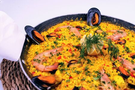 Pan with yellow rice and sea food rich mediterranean flavor