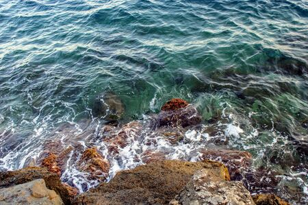 Image for backgrounds of small waves breaking on the rocks