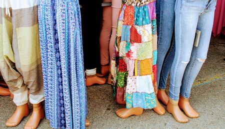 Image of colorful clothing items exposed on mannequin