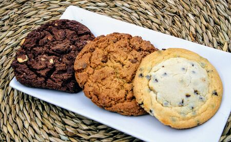 Round cookies of chocolate , oatmeal and vanilla with chocolate chips