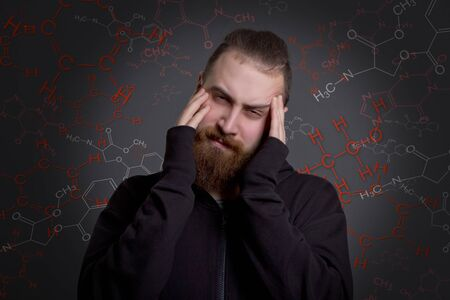 unacceptable: a young man with a beard is suffering from drugs