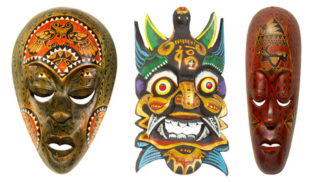 old wooden African mask on a white background