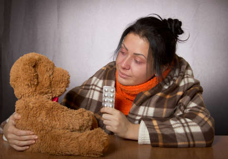 doctor toys: young girl giving medicine bear against influenza