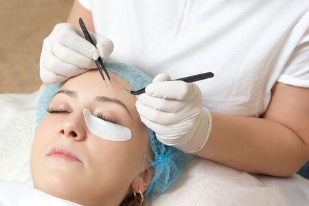 escalating: escalating of natural of eyelashes in a beauty salon