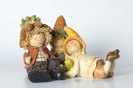 vintage German toy dwarfs with corn on white background Stock Photo
