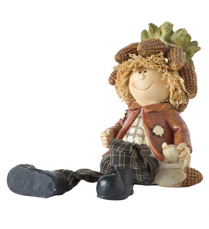 dwarfs: vintage German toy dwarfs with corn on white background Stock Photo
