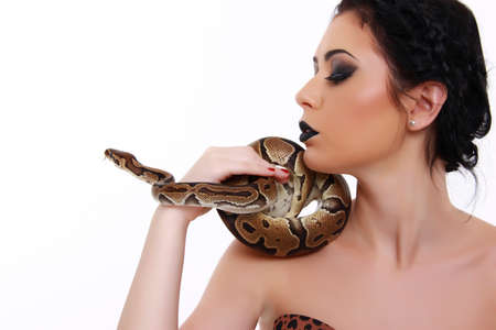 beautiful young girl with a Python in his hands