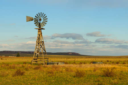 Single windmill stands on a farm at sunset Banco de Imagens - 28975163