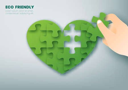 Eco friendly concept, hand holds a piece of heart shaped jigsaw puzzle,Paper art and digital craft style.