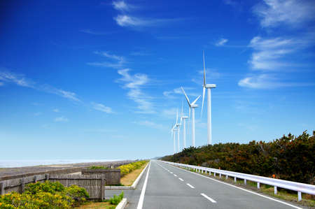 Windmills and straight roads for wind power along the coast