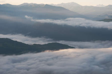 Ridges enshrouded in everpresent mist and fog, Caucasus Mountains, Georgia. photo