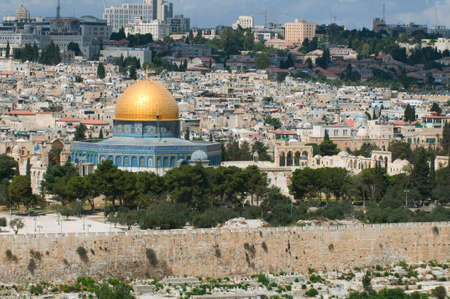 This is a panorama of Jerusalem city. Photo contains ancient buildings, domes and modern architecture on the background. photo
