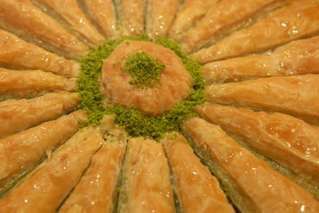 Baklava is a popular Middle Eastern pastry. This sweet is covered with honey, so it is shine. photo
