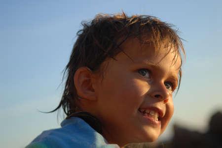 Little girl is thankful for small mercies. Girls portrait has been taken in front of  blue sky.