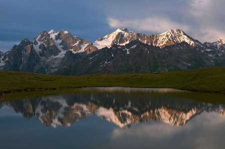 mestia: This is reflections on the mountain lake near Mestia - Caucasus mountains, Georgia, altitude 3000m  Stock Photo
